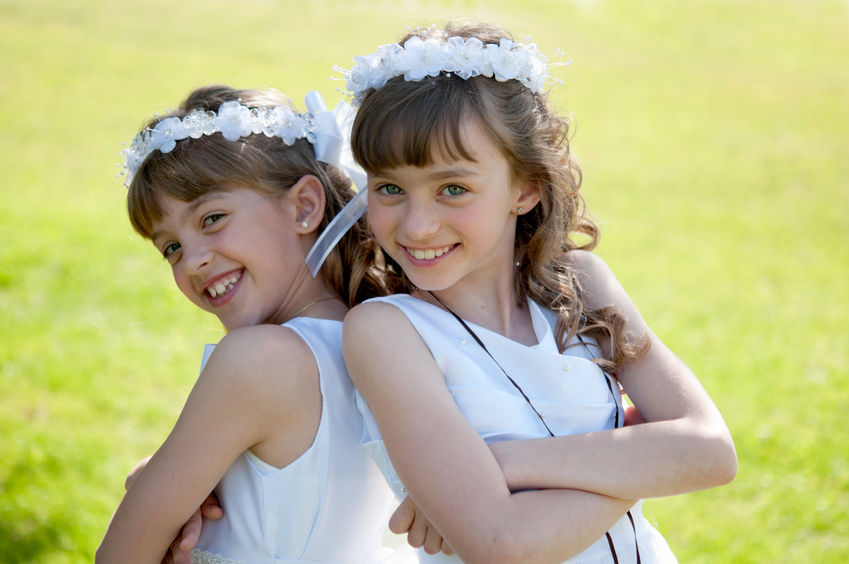 34596757 - young girls doing her catholic first holy communion