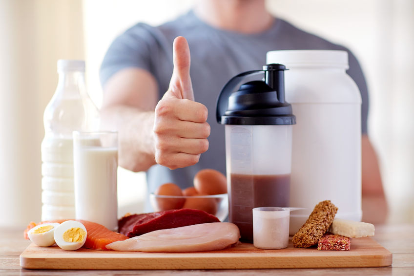 53578416 - sport, fitness, healthy lifestyle, diet and people concept - close up of man with food rich in protein showing thumbs up