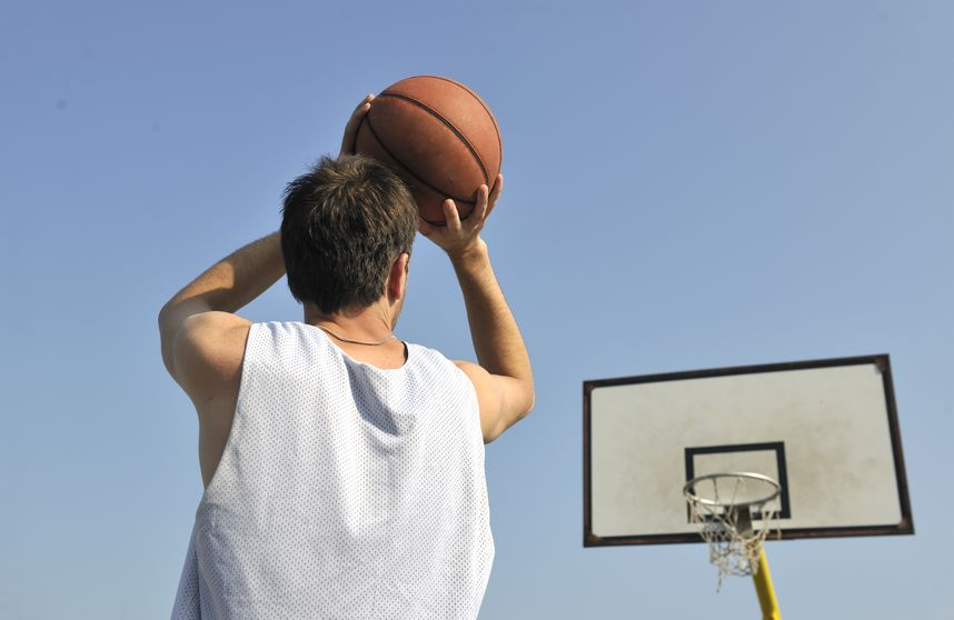 8326517 - basketball player practicing and posing for basketball and sports athlete concept