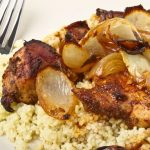 8797277 - moroccan spiced chicken with couscous and onions isolated on white.