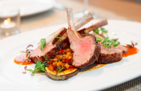 24298874 - grilled rack of lamb with vegetables on plate