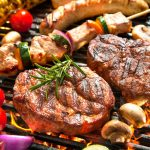 39490665 - assorted delicious grilled meat with vegetable over the coals on a barbecue
